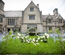 wedding ceremony on grass lawn mansion in pittsburgh, pennsylvania grey stone