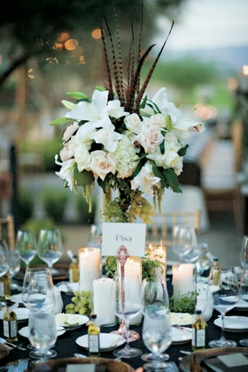 Wedding reception centerpiece with white flowers and grapes