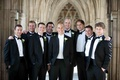 Groom with groomsmen in tuxes at Duke University Chapel