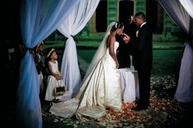 Bride takes communion at nighttime wedding ceremony