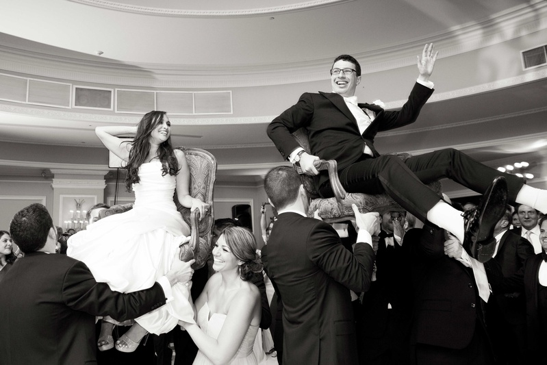 Black And White Photo Of Bride Groom During Hora Wedding Dance Jewish Tradition