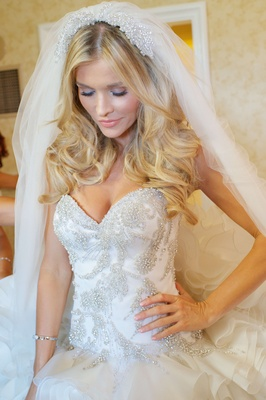 Joanna Krupa in sweetheart bridal gown with ruffles and crystals