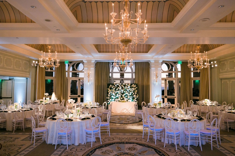 casa del mar wedding reception ballroom chandelier sweetheart table greenery white centerpieces