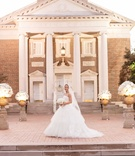 Bride in Vera Wang wedding dress in front of Perkins Chapel at Southern Methodist University