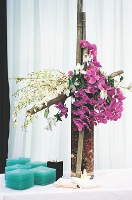 Bamboo cross with purple and white orchids