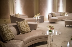 Taupe velvet modular couch at wedding reception