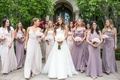 bride in vera wang wedding dress with bridesmaids in light purple dresses and light pink bouquets