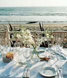 Seaside reception table decorations with ocean view