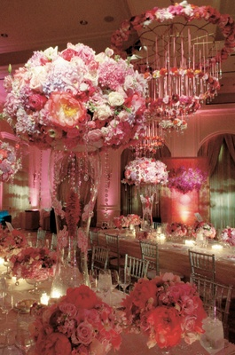 tall and short arrangements of pink flowers in pink reception room