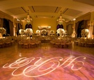 Monogram dance floor and chandliers