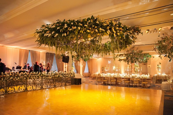 Mirror wedding band stage and flower ceiling installation over dance floor