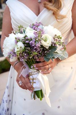 bridal bouquet with white flowers and small purple buds as an accent