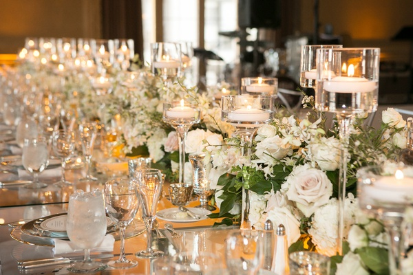 runner of flowers and floating candles in glass pedestals