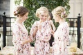 bride and bridesmaids in flowered robes