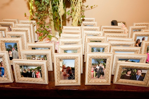 Picture frames arranged on table for guests