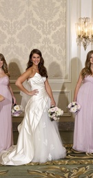 Light pink or violet dresses and floral bouquets