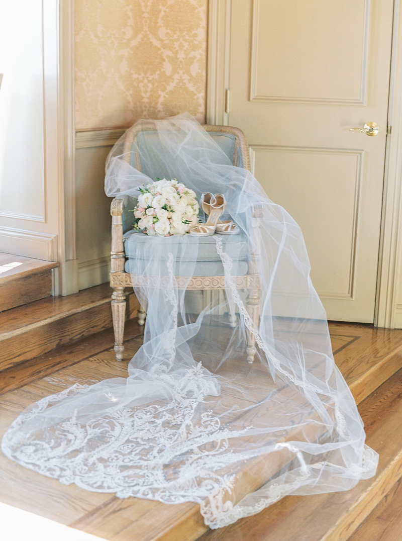 light blue antique chair beautiful veil with monogram and embroidery bouquet with high heels