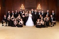 Bride and groom with bridesmaids and groomsmen in black dresses and suits
