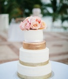 gold, white, and pink wedding cake, flower cake