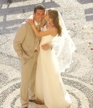Bride and groom in middle of piazza in Cinque Terre, Italy