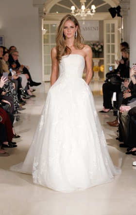 Oleg Cassini Spring 2019 collection strapless tulle gown with appliques corset and pearl buttons