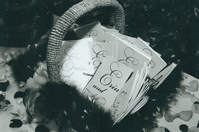 basket filled with wedding programs