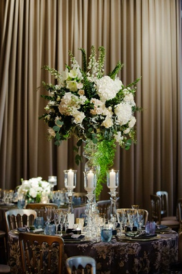 wedding reception tall centerpiece white hydrangea rose flowers candles crystal stand gold blue