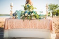 mermaid, beach-inspired tablescape with sequin tablecloth greenery blue flowers white florals