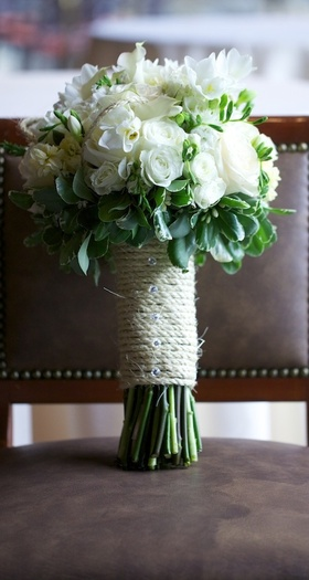 White rose bouquet with green leaves and twine