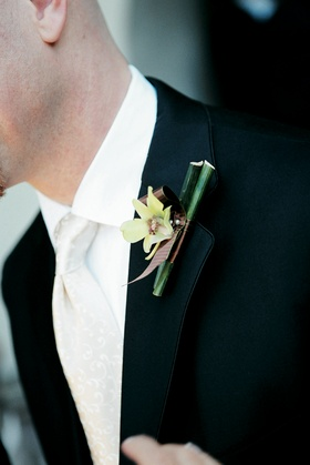 Groomsman with orchid attached to tuxedo