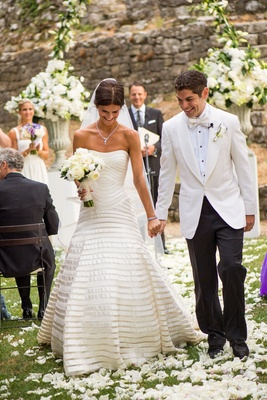 Bride in a strapless Vera Wang gown with champagne bands with groom in tuxedo with white coat exit