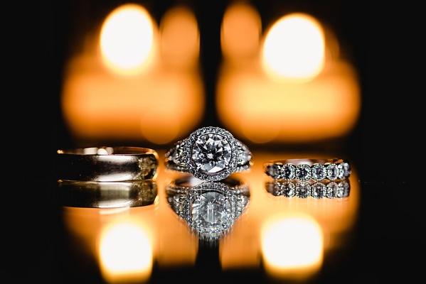 halo engagement ring with side stones, half-eternity wedding ring, plain gold wedding band