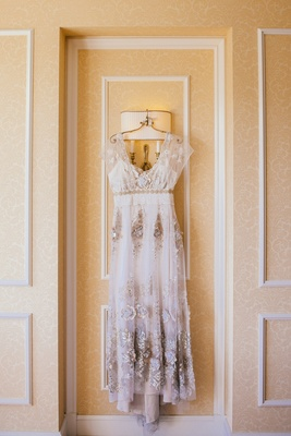 Bride's Claire Pettibone dress with gold and silver embroidery, smoky details, flutter sleeves