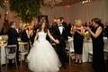 wedding reception bride and groom walking toward dance floor announcement husband and wife reception