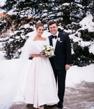 bride and groom portrait bride in white fur wrap snow on trees mother's wedding dress groom bow tie