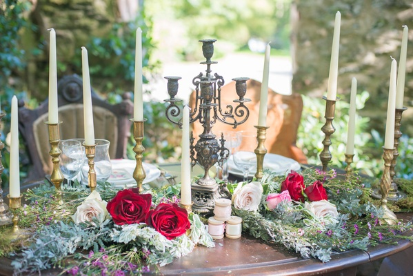 rustic wooden sweetheart table celtic wedding greener red roses pink flowers gold candles