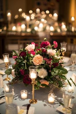 Wedding centerpiece garden rose dahlia greenery leaves gold candle holders votives wedding ideas