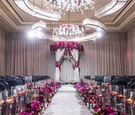 elegant las vegas wedding ceremony, fuchsia flowers, mirrored details, floating candles, grey chairs