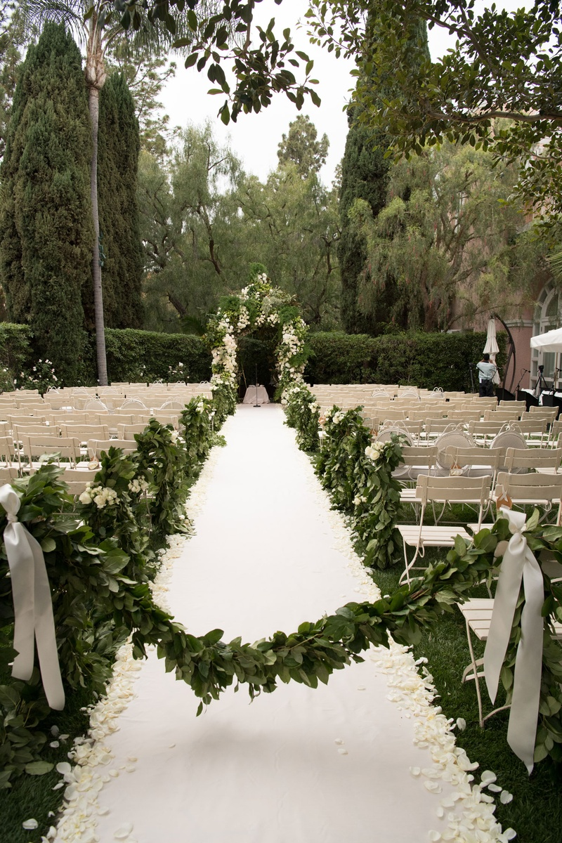 White and green wedding outdoor garden motif beverly hills hotel stone aisle white aisle runner peta