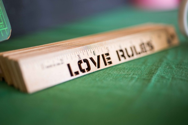 School theme bridal shower with love rules stamped stencil rulers on tables