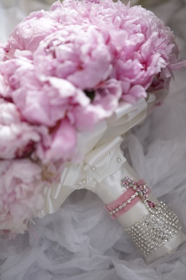 Bridal bouquet wrapped in ribbon and crystals
