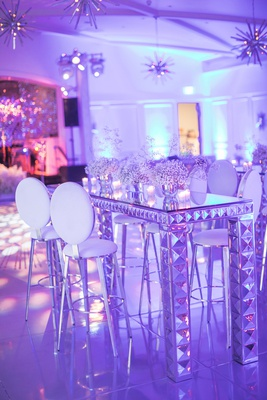 wedding after party mid century sputnik lighting chandeliers mirror cocktail bar table white stools