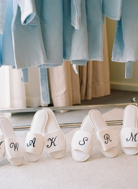 White monogrammed slippers and blue robes