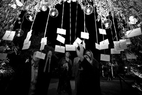 Black and white photo of seating card tree display