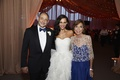 Bride in Oscar de la Renta dress with mother of bride and father of bride
