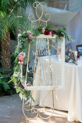 window pane welcome sign for wedding with draped floral vines