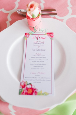 table setting for springtime bridal shower with floral menu and modern linens