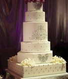 White wedding cake with silver details and rhinestones