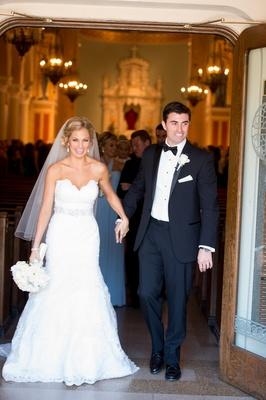 bride and groom exit St. Monica's church in Santa Monica, CA