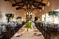 wedding reception bel air bay club fireplace reception room wood beams chandelier pendant greenery